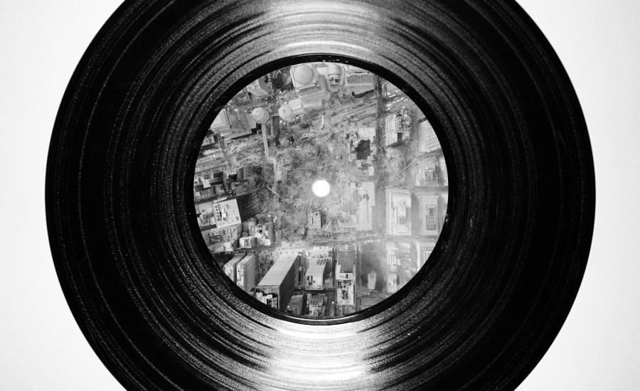 An image of a vinyl record with an aerial view of the World Trade rubble by What Went Wrong Or Right With...? for whatwentrightwith.com